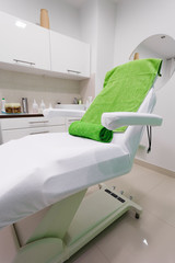 Chair in healthy beauty spa salon. Interior of treatment room.