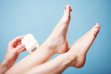 woman shaving leg with shaver depilation body care