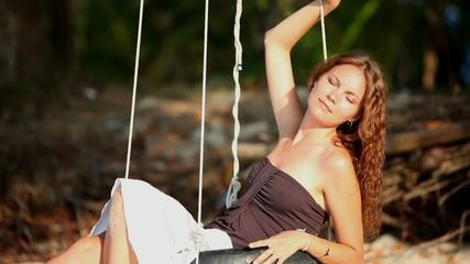 Girl swinging near the beach