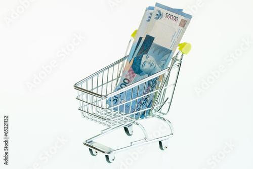 Foto op Plexiglas Indonesië Indonesian Rupiah in shopping cart close-up