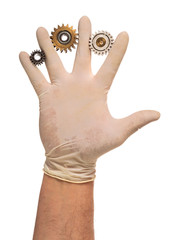 Hand in latex glove with used gears
