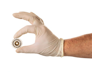 Hand in latex glove with used gear
