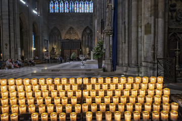 votive candles in paris cathedral