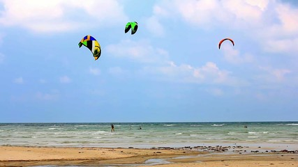 Kite surfing. Man on a parachute surfing