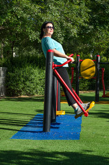 Woman swinging on a air walker station outdoor