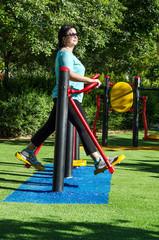 Woman training on a air walker machine outdoor