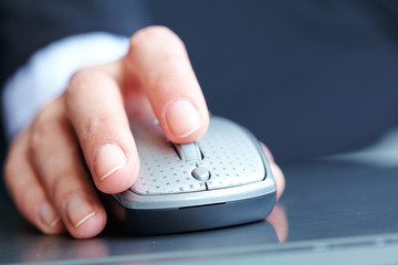 female hand clicking computer mouse