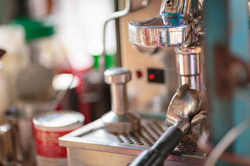 make coffee by Espresso americano Machine in coffee shop