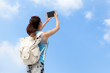 Happy woman traveler photo by tablet pc