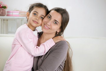 Happy young mother with daughter