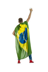 young Brazil supporter in super hero pose with Brazil Flag