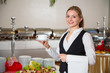 Catering service  employee in restaurant posing with soup dish - 65233947