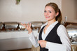 Waitress posing with plate in restaurant