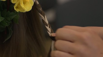 Weaving braids - ribbon in her hair