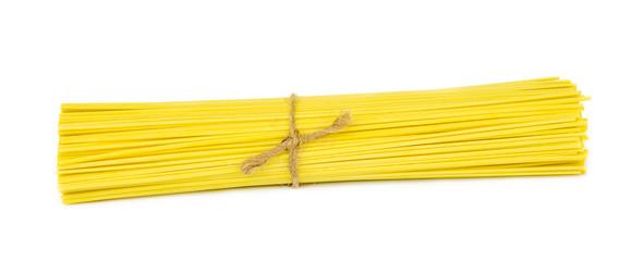 uncooked italian spaghetti .