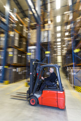 Forklif driving trough a warehouse