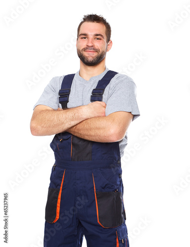 Portrait of smiling worker in blue uniform - 65237965