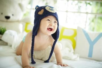 Cute baby wearing a blue bear hat