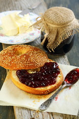 Bagel with butter and jam for breakfast.