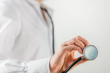 Doctor holding stethoscope