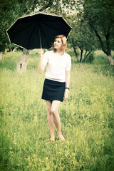 smiling girl with umbrella outdoors