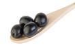 Black olives in wooden spoon