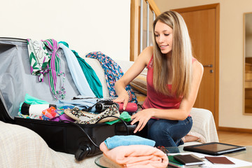 Woman trying to find room for all the things in trunk