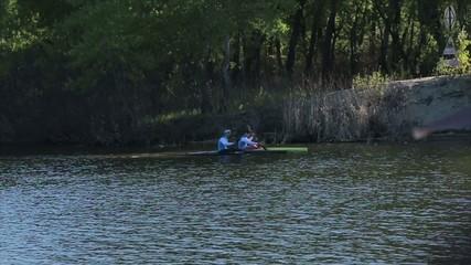 Two men paddle a kayak