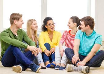 five smiling teenagers having fun at home