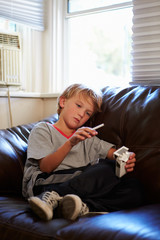 Boy Discovering Parent's Pack Of Cigarettes At Home