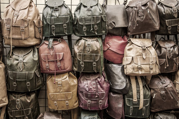 Leather backpacks background.