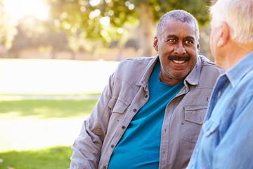 Two Senior Men Talking Outdoors Together