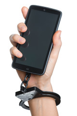 Mobile phone addiction concept. Smartphone and handcuff in hand