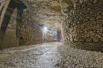 a ghost shape inside Paris Catacombs Skulls and bones