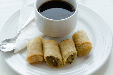 Spring roll and cup of coffee.