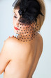 creative nude with fascinator