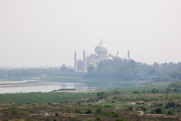 Taj Mahal downriver on the banks of the Yamuna