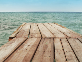 Wooden dock and Mediterranean sea with sky