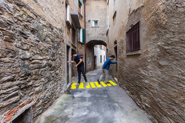 concept of contextualization, zebra crossing in a small alley
