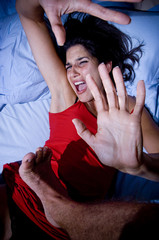 Battered woman on bed