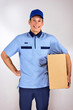 Happy young delivery man carrying carton box.