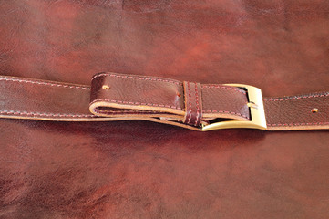 Brown leather background with belt