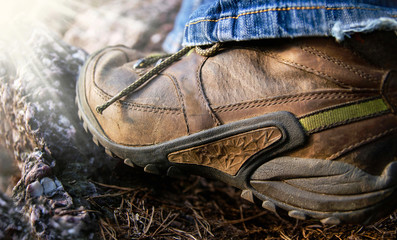 Hiking boots in outdoor action on stone hill