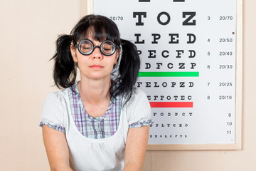 Funny woman wearing spectacles in an office at the doctor