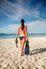 Girl and snorkeling gear