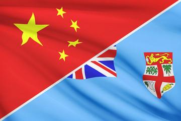 Series of ruffled flags. China and Republic of Fiji.