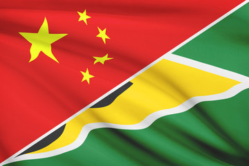 Series of ruffled flags. China and Republic of Guyana.