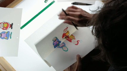 traditional animation, animator working on lightbox