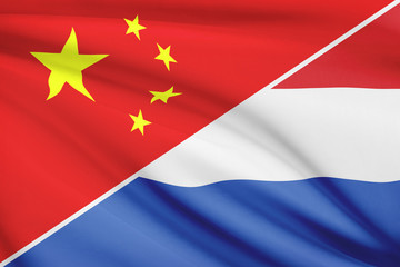 Series of ruffled flags. China and Netherlands.