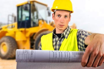 construction worker's hand holding project documents